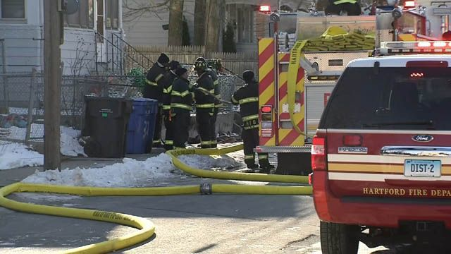Firefighters brave bitter cold temps to battle fire