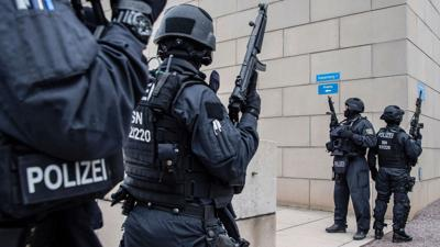 German synagogue gunman couldn't break down the door. That saved lives