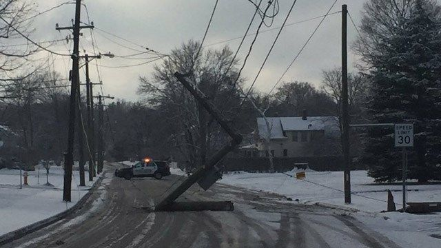 School bus snaps utility pole in Manchester
