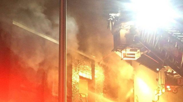 Firefighters douse flames at former manufacturing building