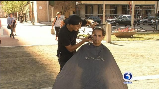 Barber gives out free haircuts in New Haven