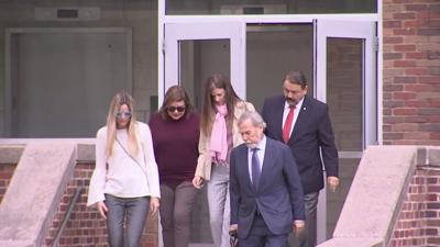 Troconis arrives at court