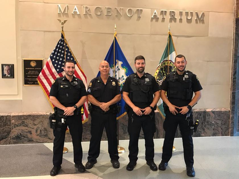 Greenwich Police Officer Sergeant Michael O'Connor and his 3 sons who are all police officers pose for a picture