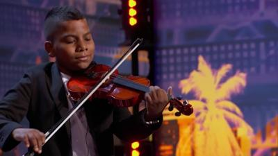 An 11-year-old cancer survivor earned a golden buzzer from Simon Cowell on 'America's Got Talent'