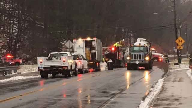 Heating oil delivery truck rollover closes road in Manchester