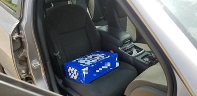 Driver charged after using case of beer as child booster seat, police say