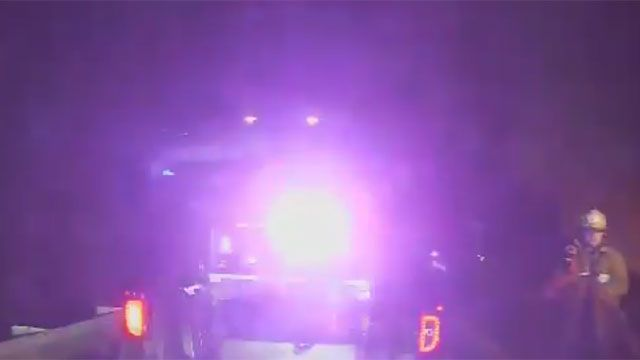 CT police rescue driver trapped in burning car