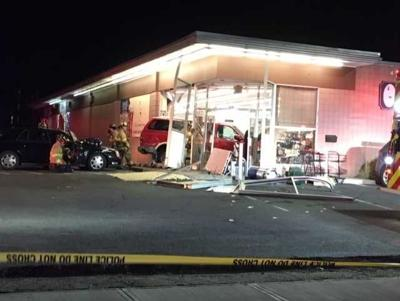 PD: Person struck, one arrested after car into Milford liquor store