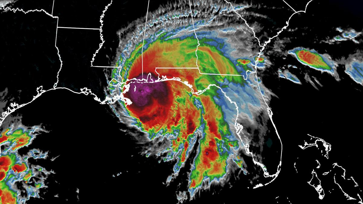 Hurricane Sally's center roars into Alabama, and its crawling pace threatens catastrophic flooding