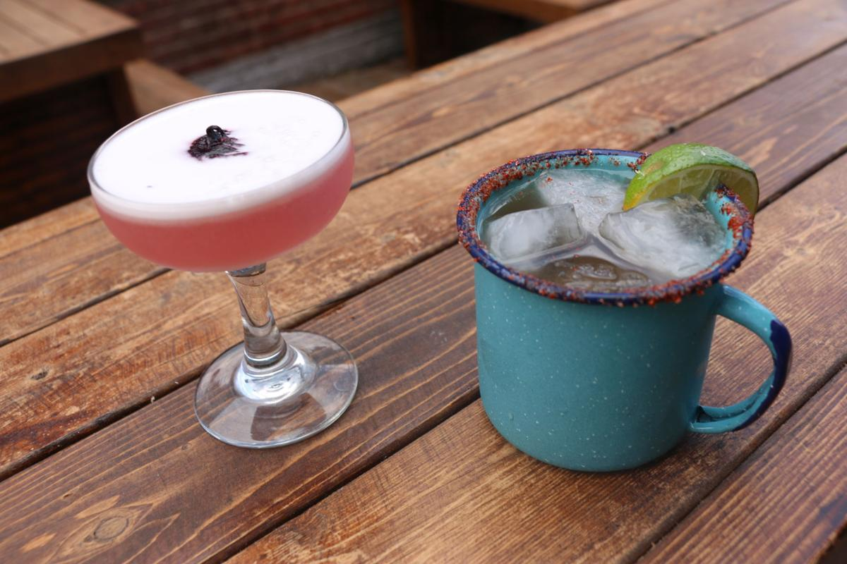 Hibiscus gin sour (left) and the Mexi-mule (made with tequila and tamarind)