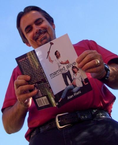 """Alan Riehl with his previous self-published book, """"Married Alive."""""""