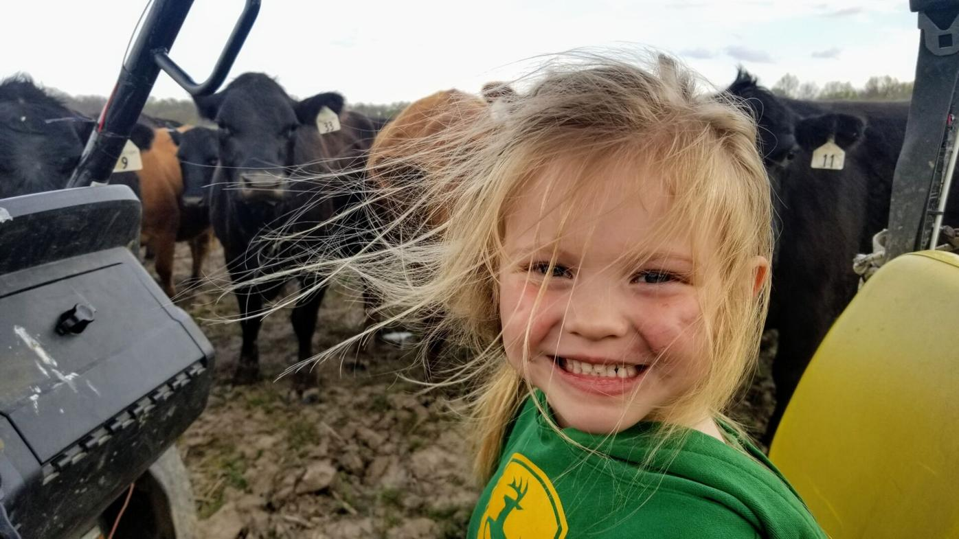 All Smiles While Feeding the Cows