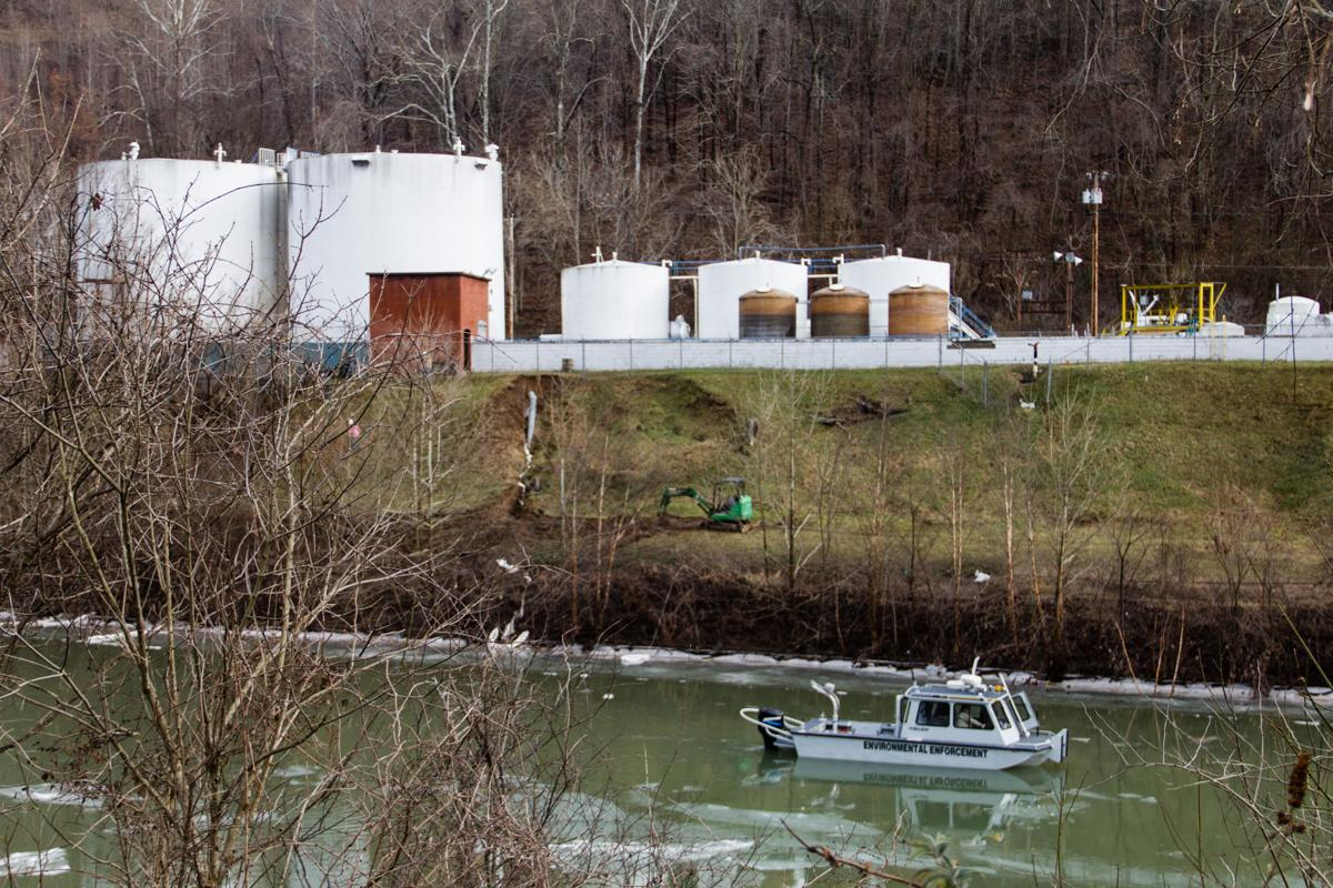 An environmental enforcement boat patrols in front of the chemical spill at Freedom Industries