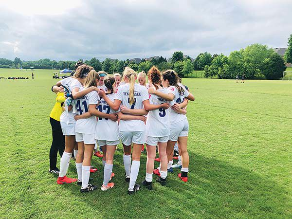 TSC Showcase 04 Girls U15 team prayer after defeating TUSC 04 Red in the Final game of the TNI Tournament to win their bracket.