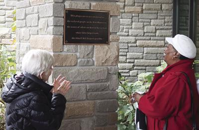 City of Brentwood Commissioner Anne Dunn and Carolyn Hatcher applaud and smile as the new plaque is unveiled, honoring the unnamed slaves added to a stone column outside the John P. Holt Brentwood Library.
