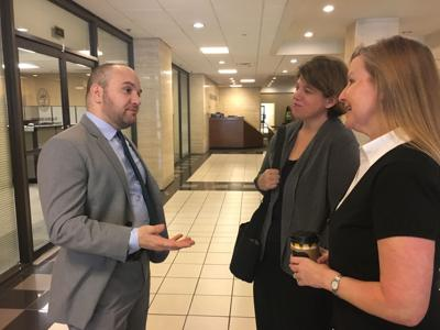 Susan Drury and Kim Henke (right) converse with their attorney Tony Orlandi