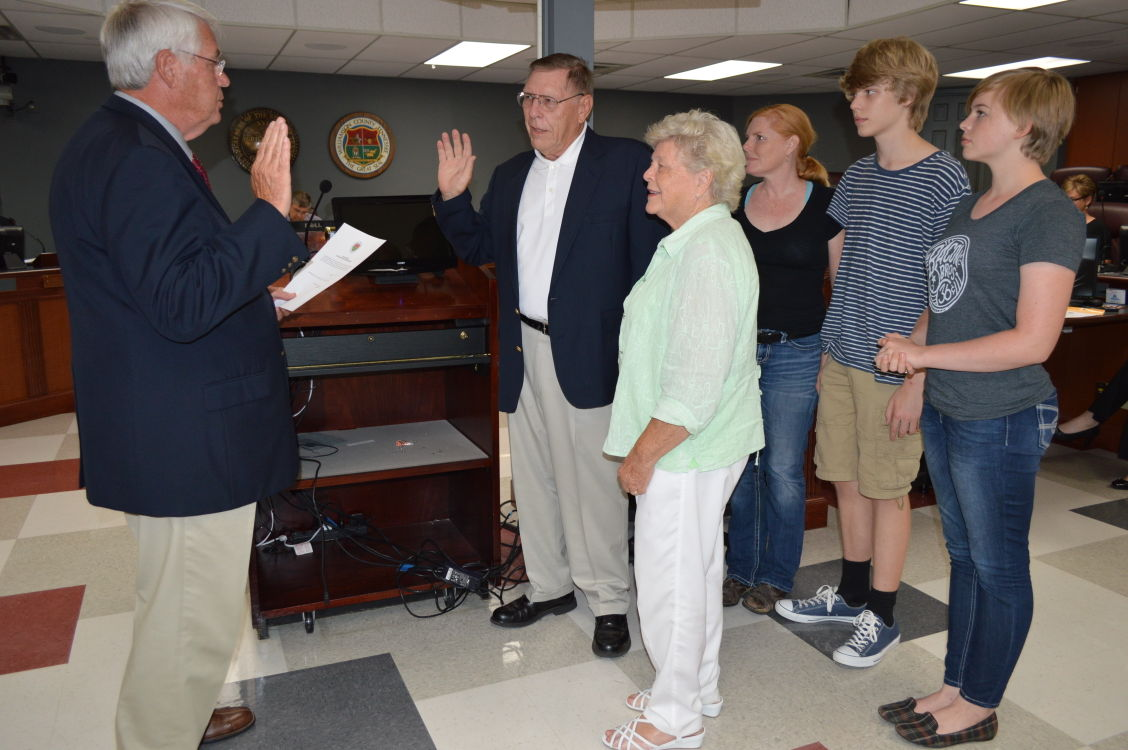 Commissioner Lew Green took his oath of office as county commissioner after re-election in 2014