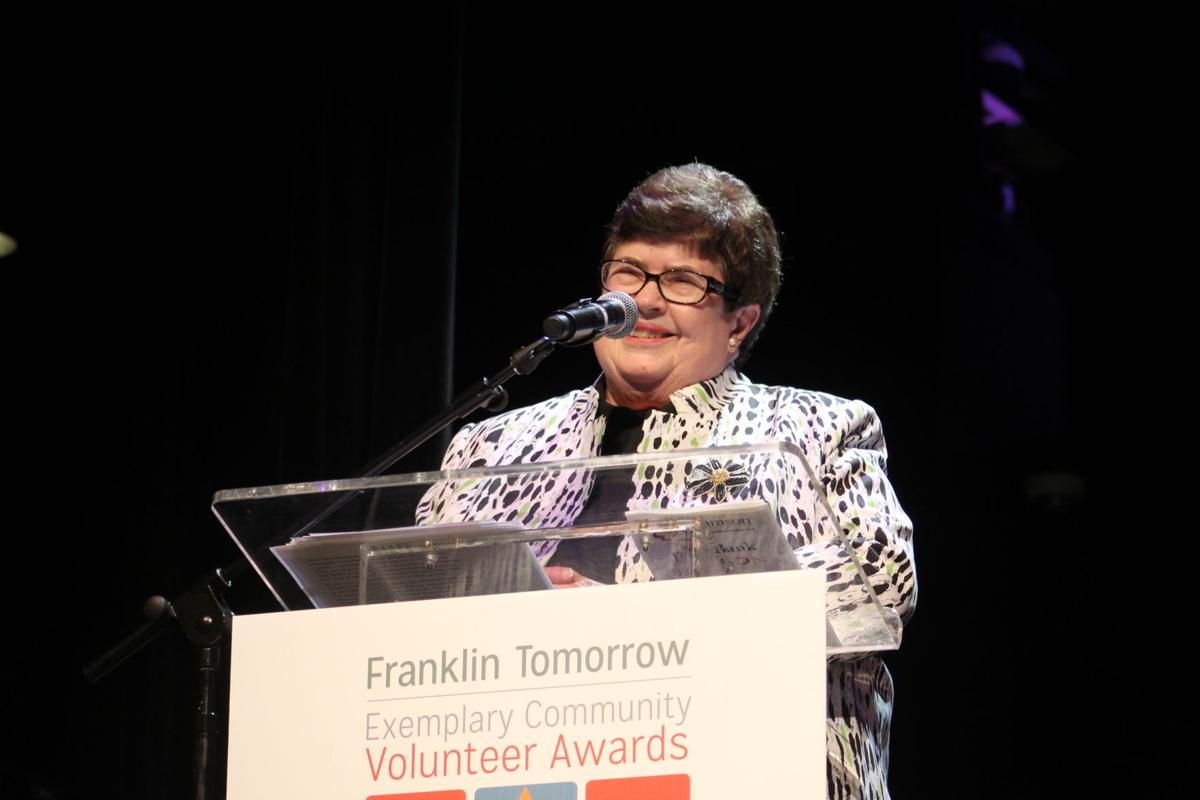 Judy Hayes accepts the Anne T. Rutherford award for her lifetime of service to our community