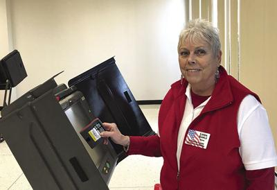 Poll worker Linda Rawls