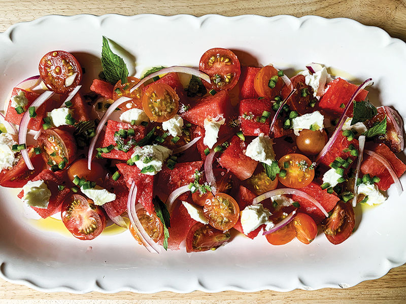 Watermelon and tomato salad with local goat cheese and mint