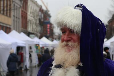Despite rain, one family keeps things sweet at Dickens of a Christmas