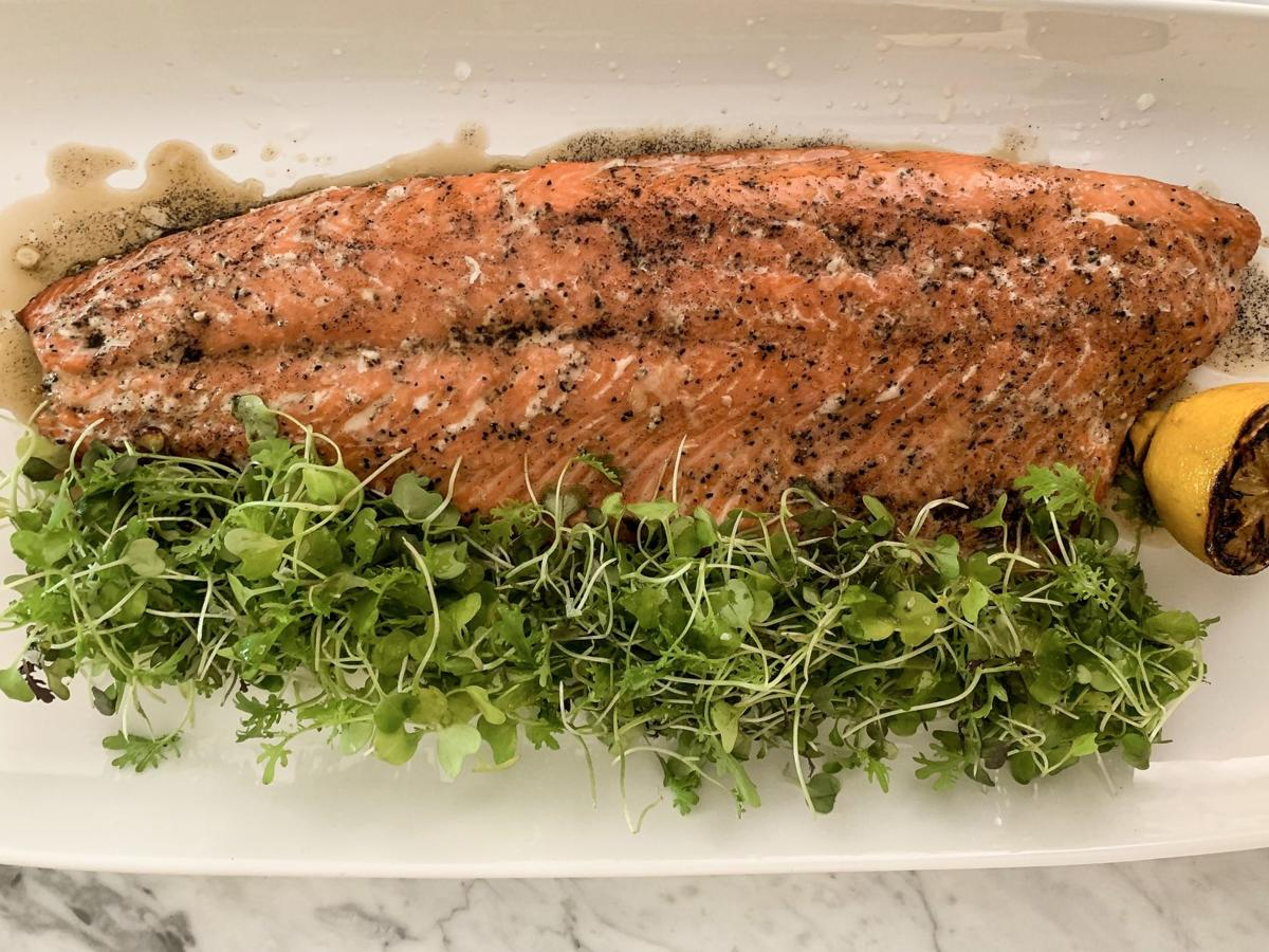Grilled Alaskan sockeye salmon with brown butter, lemon and spicy micro greens