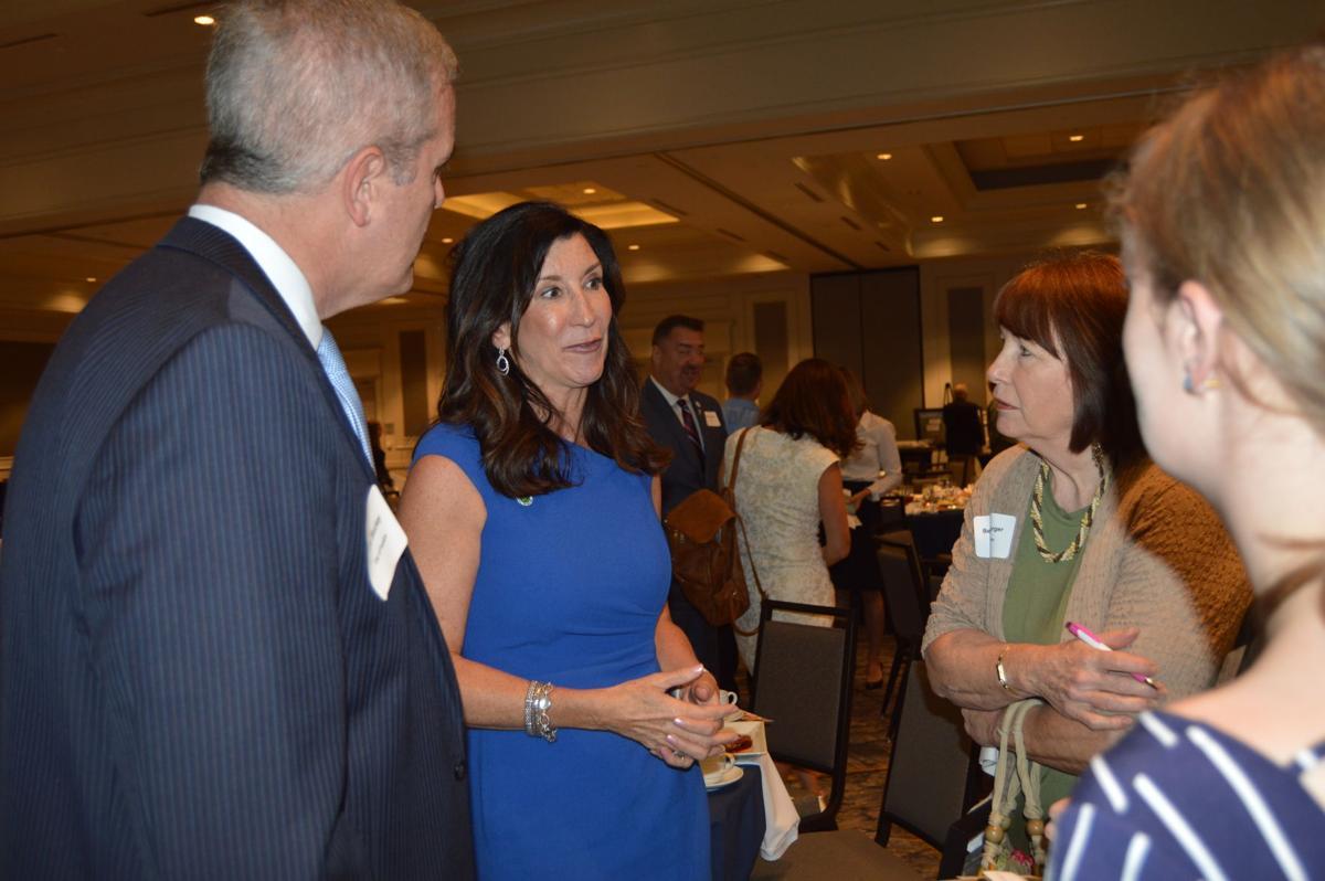 Mayor Jackie Millet speaks to summit attendees