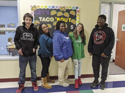Marquita Solomon stands with four teens from her after-school group.