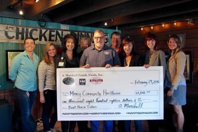 Puckett's Boat House donates to Mercy Community Healthcare