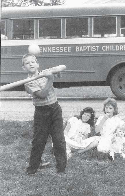 A youngster shows off his baseball skills at the Tennessee Baptist Children's Home in 1963.
