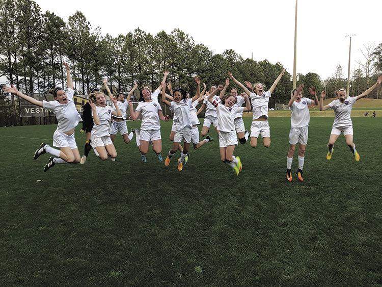 TSC player's enjoy a victory celebration at a recent tournament.