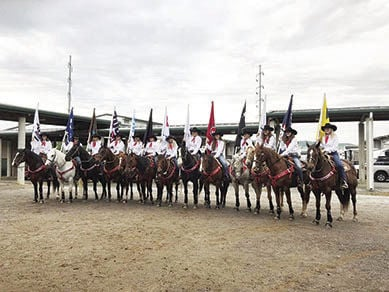The Flag Girl team line up at last year's Rodeo.