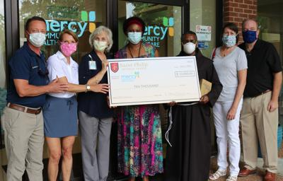 St. Philip Church donation to Mercy Healthcare