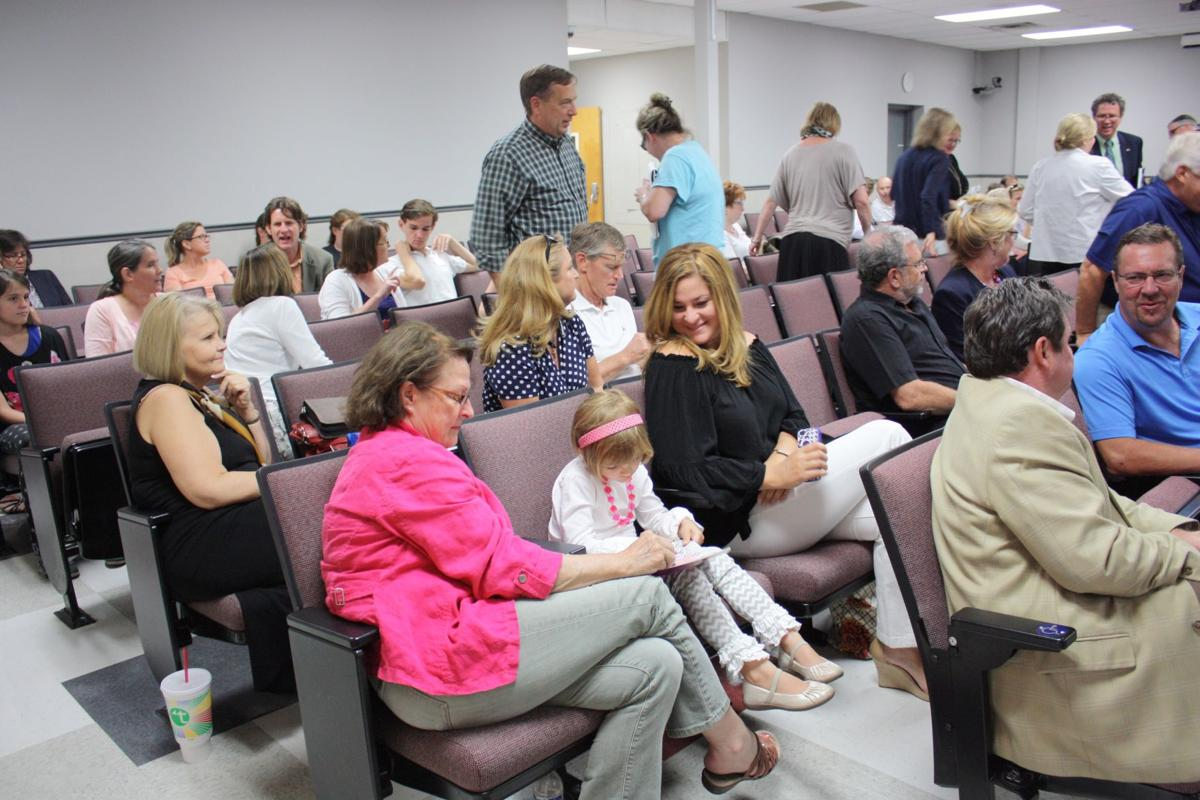 A crowd gathered in the county auditorium for the school board candidate forum Thursday
