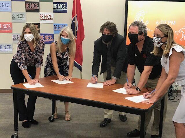 Board members signing.jpg