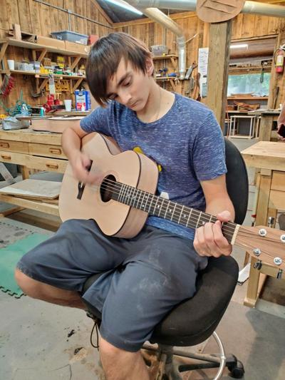 Gabe Sipos with guitar