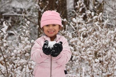 Snow girl with snowball