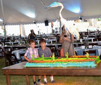 homemade-5-foot-heron-cake-by-Joan-Vaugn.-with-Sammy-Currey-and-John-Ryan-Laginess