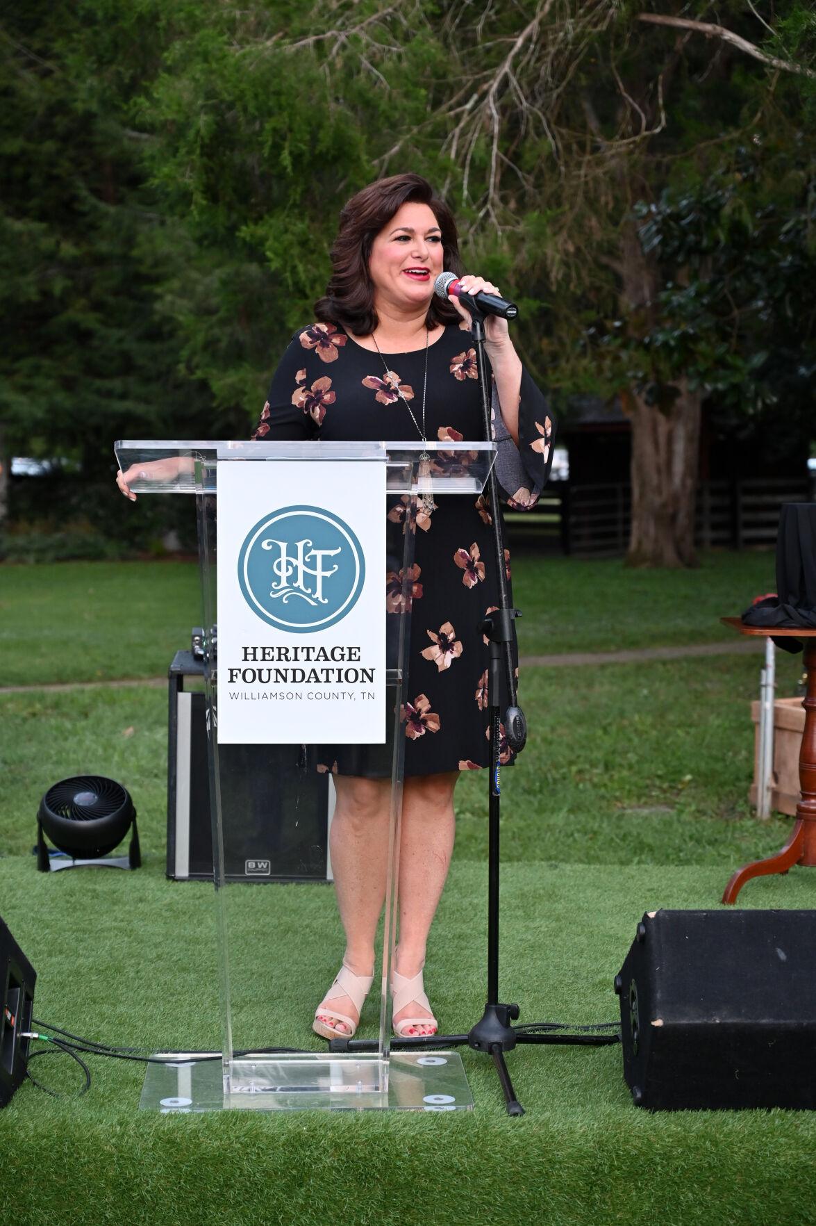 Bari Beasley at podium Patron's Party