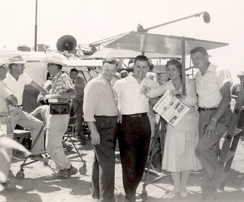Three B.F. Goodrich engineers, including Don Russell, second from left, with actress Jane Withers in 1955 on set of 'Giant' Photo courtesy of Don Russell.jpg
