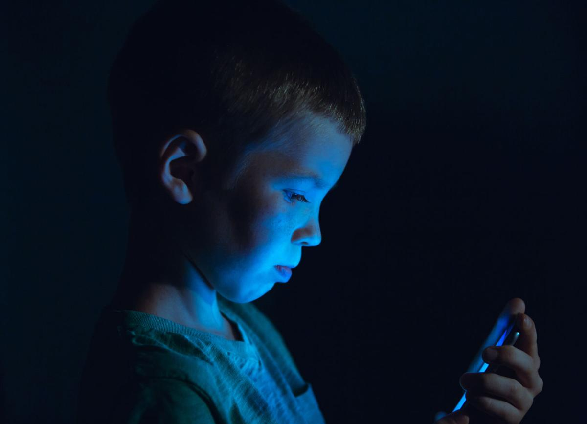 Young Boy Looking at a Device Screen kid child