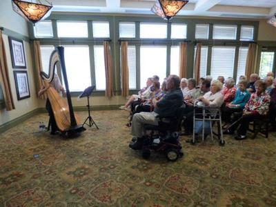 Harpist Emily Stewart performs for THAB residents
