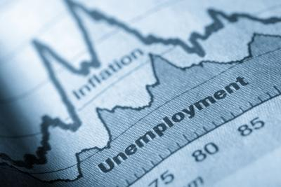 Folded sheet of paper with an unemployment graph on