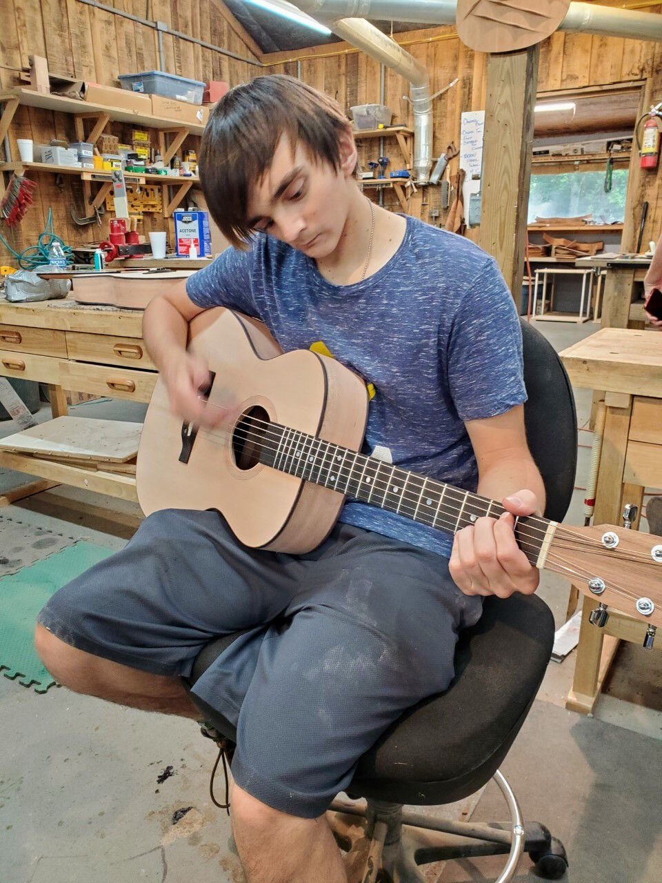 Gabe Sipos Plays the Guitar He Build at Narrow Gate Lodge.jpg