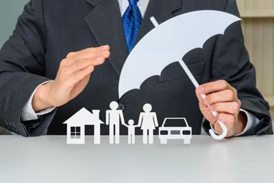 Broker / insurer holds an umbrella to protect parents e.g. father, mother, a child, a house and a sedan car