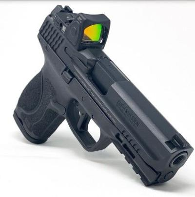 Smith and Wesson M&P M2.0 9mm pistol outfitted with a Trijicon RMR06 red dot sight.