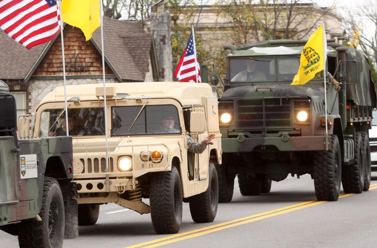 Veterans wave from their vehicles during the Wilson County Veterans Day Parade.