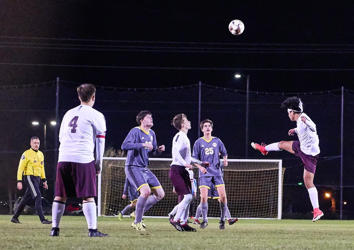 East Robertson and Merrol Hyde players battle for possession during Tuesday's game at Merrol Hyde High School.jpg