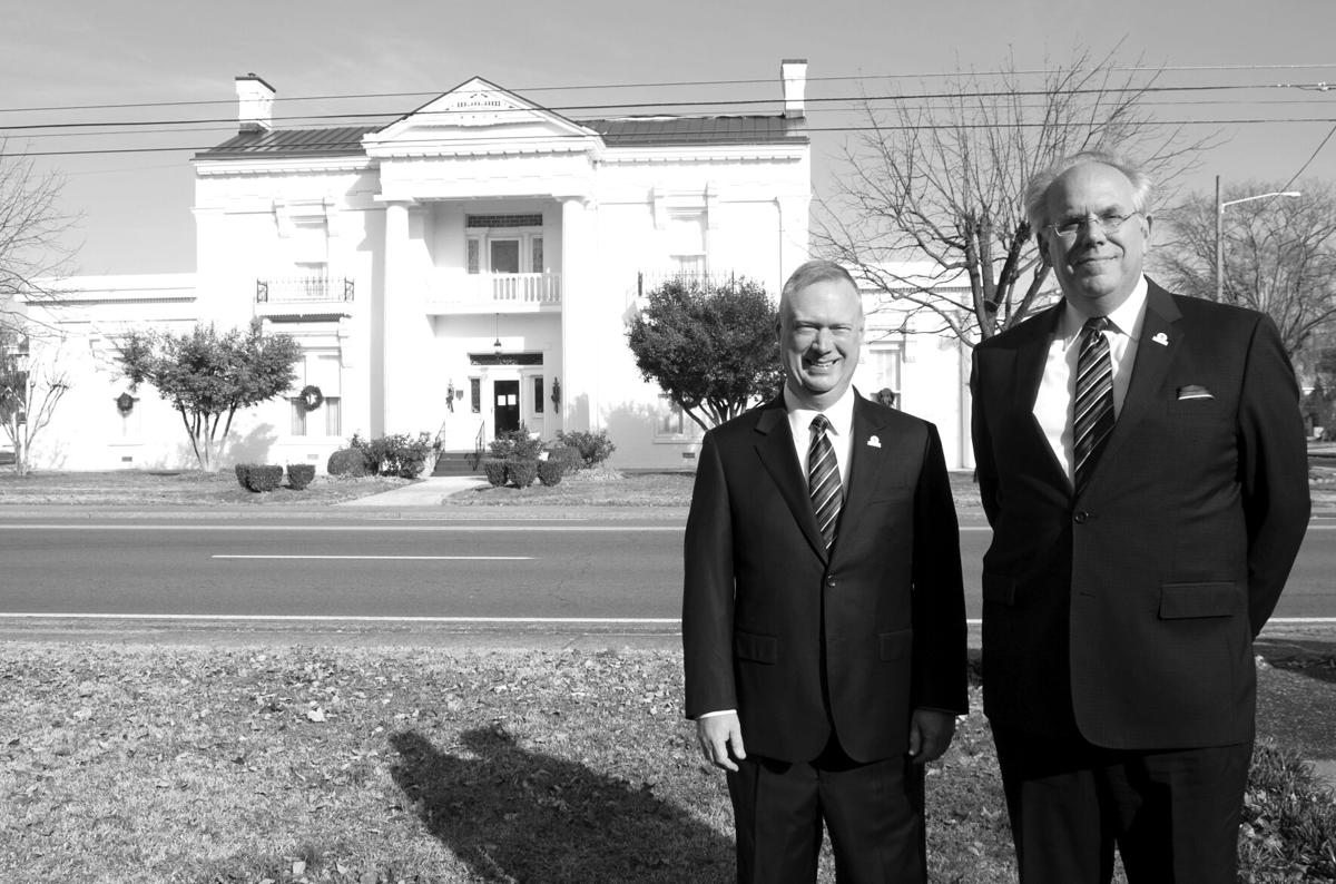 Funeral directors Clark McKinney (left) and David Brooks (right) have been co-owners of Ligon & Bobo Funeral Home since November 1993. The business observed its 100th anniversary this year and has been ensconced since 1938 in the Robert L. Caruthers house, which was built on Lebanon's West Main Street in 1828. McKinney and Brooks are Smith County natives as was Caruthers, a lawyer who helped found Cumberland University in 1842 and Cumberland School of Law in 1847 and was married to the niece of Rachel and Andrew Jackson. KEN BECK