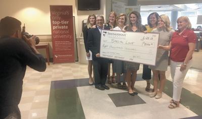 Former camper's battle against cancer inspires student group to make donation